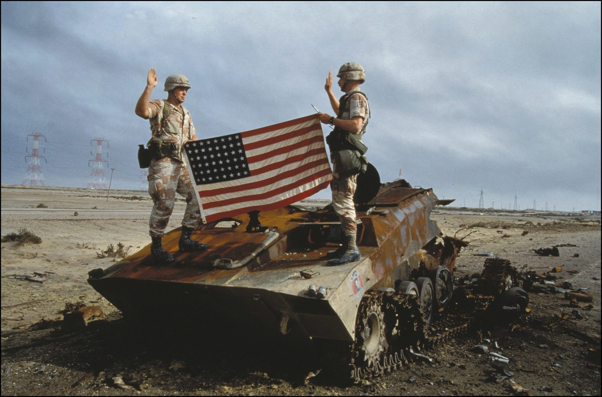 IRAQ - FEBRUARY 01:  US Soldiers Take Oath To The US Army On An Iraqi Destroyed Tank In Iraq On February 27th, 1991.  (Photo By Eric BOUVET/Gamma-Rapho Via Getty Images)